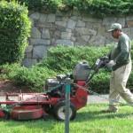Blake employee mowing
